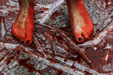The feet of an animal rights activist are covered in fake blood during a protest against wearing fur and in favour of animal rights at Madrid's Puerta del Sol