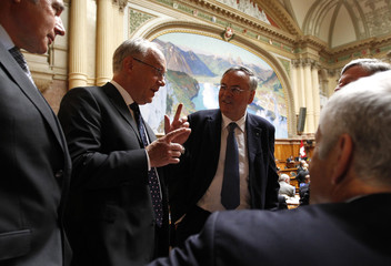 National Councillors Schneider-Ammann and Rime talk during the autumn Parliament Session in Bern