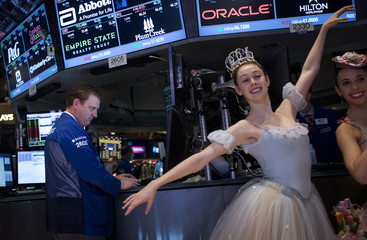 "Ballerinas from the New York City Ballet's production of ""The Nutcracker"" pose for photos on the floor of the New York Stock Exchange in New York"