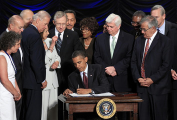 U.S. President Barack Obama signs the Dodd-Frank Wall Street Reform and Consumer Protection Act in Washington