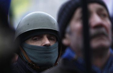 People attend an anti-government rally in Kiev