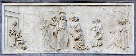 TURIN, ITALY - MARCH 15, 2017: The relief of jesus and rich young ruler on the facade of church Basilica Maria Ausiliatrice by Emilio Spalla (1897 - 1971).