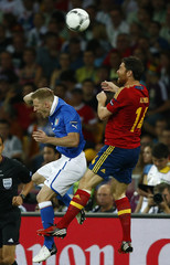 Italy's Abate heads the ball with Spain's Alonso during their Euro 2012 final soccer match at the Olympic stadium in Kiev