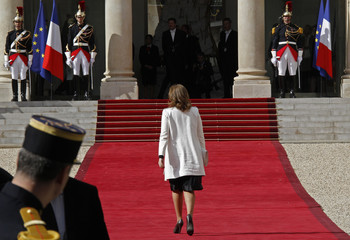 Trierweiler, companion of France's newly-elected President Hollande, arrives for the handover ceremony between her husband and outgoing President Sarkozy at the Elysee Palace in Paris