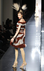A model presents a creation by French designer Jean-Paul Gaultier as part of his Haute Couture Spring-Summer 2011 fashion show in Paris