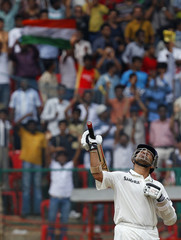 India's Tendulkar celebrates scoring a half century during the fifth day of their second test cricket match against Australia in Bangalore
