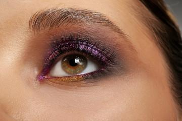 Face of young woman with beautiful makeup, closeup
