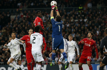 Liverpool's Toure watches as Real Madrid's goalkeeper Casillas makes a save during their Champions League Group B soccer match against Liverpool at Santiago Bernabeu stadium in Madrid