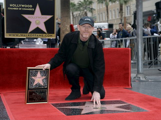 Ron Howard touches his star on the Hollywood Walk of Fame after being honored with the 2,568th star in Los Angeles, California