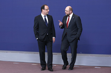 France's President Hollande listens to European Parliament President Schulz as they pose for a family photo during an European Union leaders summit meeting in Brussels