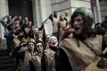Protesting students wearing fake military uniforms participate in a demonstration in front of Sofia University