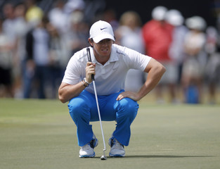 Northern Ireland's McIlroy looks at his putt during the 2013 WGC-Cadillac Championship PGA golf tournament in Doral
