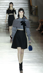 A model presents a creation by Italian designer Miuccia Prada for Italian fashion house Miu Miu as part of their Spring/Summer 2012 women's ready-to-wear fashion show in Paris