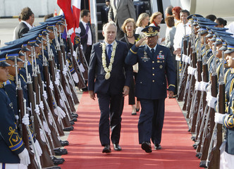 French PM Ayrault reviews honour guards upon arriving at Manila International Airport