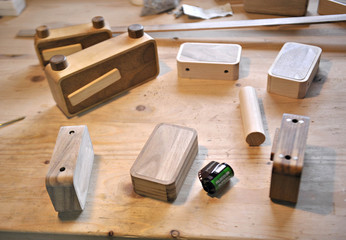 A roll of film is seen among wooden pinhole cameras on the work-bench at the Ondu design and fabrication studio in Lopatnik