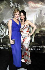 """Gugino and Cornish pose at the premiere of """"Sucker Punch"""" at the Grauman's Chinese theatre in Hollywood"""