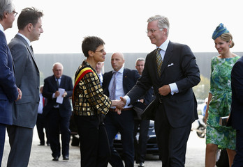 Belgium's King Philippe shakes hands with NVA party president and Mayor of Antwerp De Wever as he arrives at Mas Museum during Joyous Entry of the royal couple in province of Antwerp