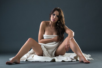 Beautiful Sensual nude woman covered in white cloth