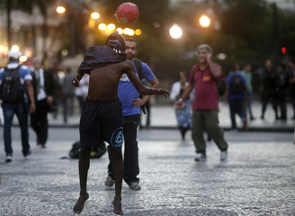 Anti-government demonstrator plays with a soccer ball as he takes part in the Occupy the Municipal Chamber movement in Rio de Janeiro