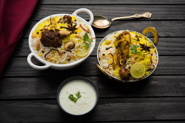 kashmiri Mutton Gosht Biryani / Lamb Biryani / Mutton Biryani served with Yogurt dip, selective focus