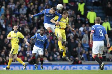 Rangers' Mervan Celik challenges Kilmarnock's Liam Kelly for the ball during their Scottish Premier League soccer match in Scotland