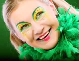 crazy woman over green background