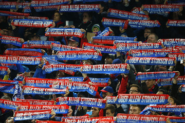 Fans of FC Basel cheer for the team before their Champions League Group B soccer match against Real Madrid in Basel