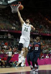Lithuania's Kleiza goes in for a lay-up past Bryant and James both of the U.S. during their men's preliminary round Group A basketball match at the Basketball Arena during the London 2012 Olympic Games