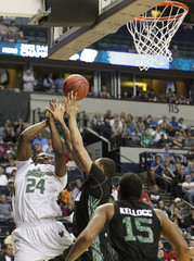 University of South Florida Bulls Augustus Gilchrist fights for the ball with Ohio Bobcats players during their NCAA third round basketball game in Nashville