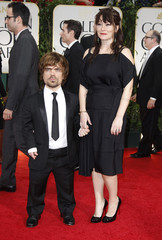 Actor Peter Dinklage and wife Erica Schmidt arrive at the 69th annual Golden Globe Awards in Beverly Hills