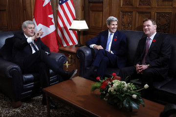 Canada's PM Harper meets with U.S. Secretary of State Kerry and Canada's Minister of Foreign Affairs Baird on Parliament Hill in Ottawa