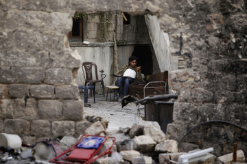 A Free Syrian Army fighter rests in Aleppo's Karm al-Jabal district