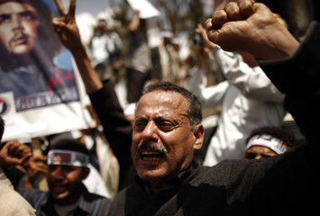 Member of Parliament Hashed shouts slogans during a demonstration calling for greater independence of the judicial system outside the Ministry of Justice in Sanaa