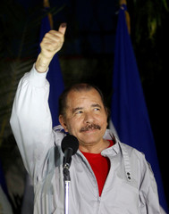 Daniel Ortega shows his ink stained thumb to the media after casting his vote at a polling station during Nicaragua's presidential election in Managua