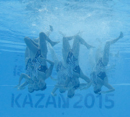 Team China perform underwater their synchronised swimming team technical routine preliminary at the Aquatics World Championships in Kazan