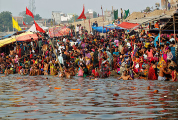 Hindu devotees gather to take a holy dip in the river Ganga on the occasion of the annual Hindu festival of 'Karthik Purnima' or full moon night, in Allahabad