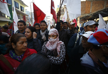 Supporters of Unified Communist Party of Nepal (Maoist) participate in their election campaign in Kathmandu