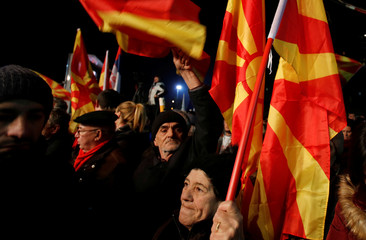Supporters of the biggest opposition party SDSM shout slogans during a pre-election rally in Skopje