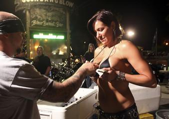 Beer girl Diana Brandetsas of Myrtle Beach works for tips at Suck Bang Blow biker bar in Murrells Inlet