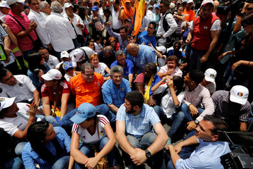 Ramos Allup, President of the National Assembly and members of opposition parties (MUD) take part during a rally to demand a referendum to remove President Nicolas Maduro in Caracas