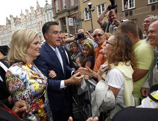 U.S. Republican presidential candidate Mitt Romney and his wife Ann meet people on the street before his meeting with Poland's Prime Minister Donald Tusk at the Old Town Hall in Gdansk