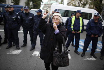 A protester blows a whistle during a demonstration in central Sofia