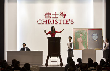 "A Christie's moderator facilitates the sale of an artwork titled ""Self-Portrait with Skeleton Arm and Madonna after Edvard Munch "" by artist Andy Warhol during a Christie's auction in Shanghai"