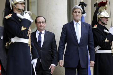 French President Hollande welcomes US Secretary of State Kerry at the Elysee Palace in Paris