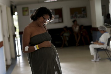 Elizangela Marques, who is six months pregnant, poses for a picture at the IMIP hospital in Recife