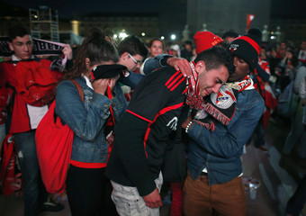 Benfica's fans react after watching their club lose their Europa League final soccer match against Chelsea in Lisbon