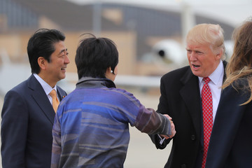U.S. President Donald Trump shakes hands with Akie Abe, wife of Japanese Prime Minister Shinzo Abe, while boarding Air Force One as they depart for Palm Beach, Florida, at Joint Base Andrews