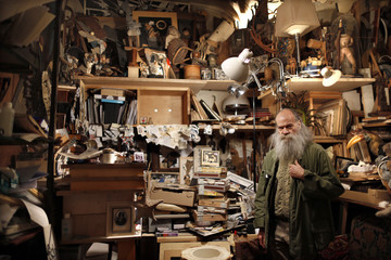 Alain Le Yaouanc, a 74-year-old French artist, poses in his apartment and studio in Paris
