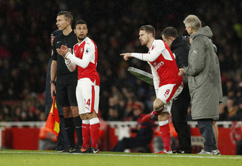 Arsenal's Francis Coquelin and Aaron Ramsey before coming on as substitutes