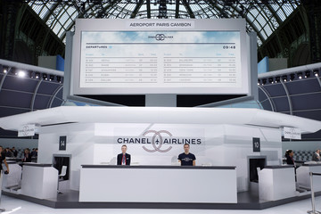 A view shows a Chanel airlines counter at the Grand Palais which is transformed into a Chanel airport before German designer Karl Lagerfeld's Spring/Summer 2016 women's ready-to-wear collection in Paris